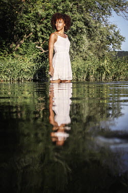 Stephen Carroll YOUNG BLACK WOMAN REFLECTED IN LAKE Women