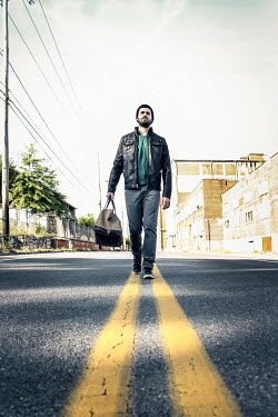 Stephen Carroll MODERN MAN WITH BAG ON URBAN STREET Men