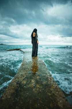 Ebru Sidar WOMAN ON SEASIDE JETTY AT HIGH TIDE Women