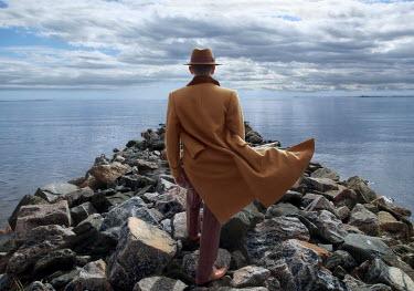 Efim Shevchenko RETRO MAN IN HAT ON ROCKS BESIDE SEA Men