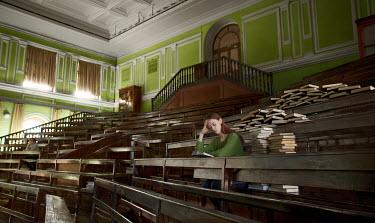 Efim Shevchenko YOUNG WOMAN STUDYING BOOKS INSIDE CLASSROOM Women