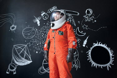 Efim Shevchenko MAN IN SPACESUIT BESIDE DRAWINGS INDOORS Men