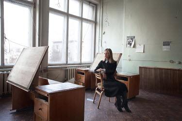 Efim Shevchenko WOMAN SITTING AT DESK INSIDE CLASSROOM Women