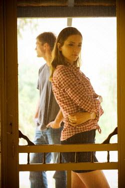 Joshua Sheldon YOUNG MODERN COUPLE STANDING OUTSIDE BY DOOR Couples