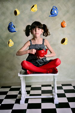 Tanya Gramatikova YOUNG GIRL INDOORS WITH FLOATING CUPS Children