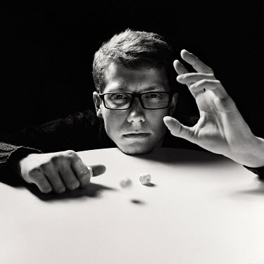 Daniil Kontorovich MAN WEARING GLASSES THROWING DICE Men