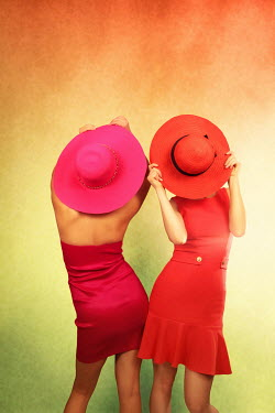 ILINA SIMEONOVA TWO WOMEN WEARING COLOURFUL HATS INDOORS Groups/Crowds