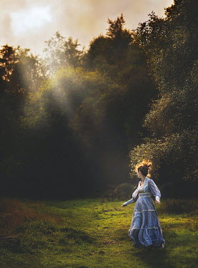 Jessica Drossin VINTAGE WOMAN RUNNING IN COUNTRYSIDE Women