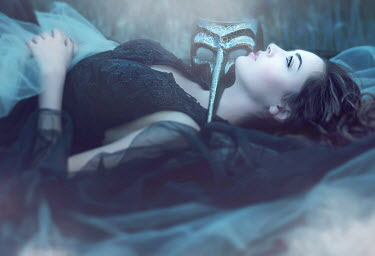 Jessica Drossin DARK HAIRED WOMAN WITH MASK LYING OUTSIDE Women