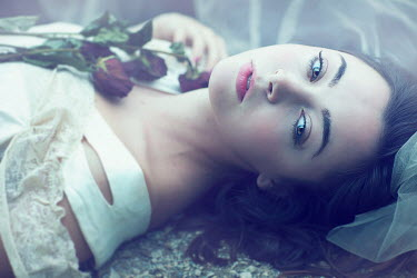 Jessica Drossin DARK HAIRED WOMAN WITH ROSES LYING OUTSIDE Women