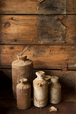 Kathy Harcom FOUR DIRTY CERAMIC BROWN JARS INDOORS Miscellaneous Objects
