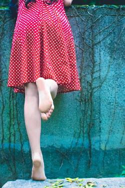 Elly De Vries YOUNG WOMAN IN POLKA DOT DRESS OUTSIDE Women