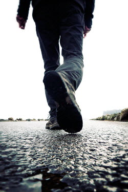 Tim Robinson MAN WALKING ON GRAVEL ROAD OUTSIDE Men