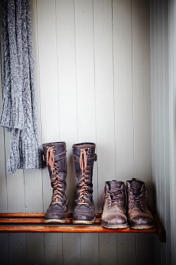 Andy & Michelle Kerry TWO PAIRS OF BOOTS ON SHELF INDOORS Miscellaneous Objects