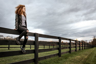 Stephen Carroll YOUNG WOMAN SITTING ON FENCE Women