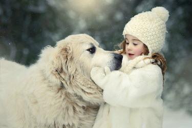 Viktoria Haack LITTLE GIRL IN SNOWY COUNTRYSIDE WITH DOG Children