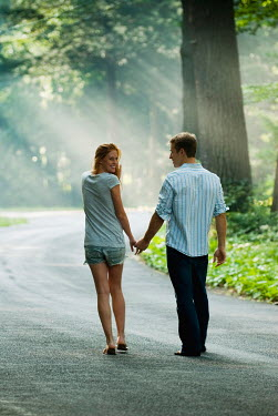 Joshua Sheldon YOUNG COUPLE HOLDING HANDS ON COUNTRY ROAD Couples