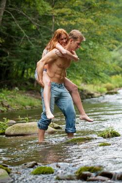 Joshua Sheldon MAN CARRYING HAPPY WOMAN ACROSS STREAM Couples