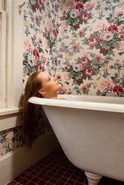 Joshua Sheldon YOUNG WOMAN RELAXING IN BATHTUB INDOORS Women