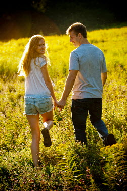 Joshua Sheldon YOUNG COUPLE HOLDING HANDS IN FIELD Couples