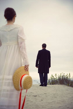 Susan Fox BRIDE AND GROOM STANDING ON BEACH Couples