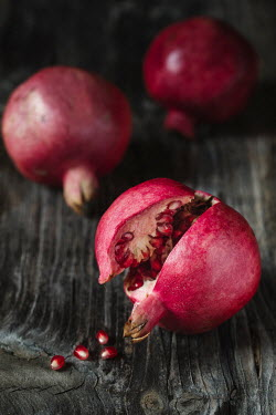 Alberto Bogo CLOSE UP OF THREE POMEGRANATE FRUITS Miscellaneous Objects