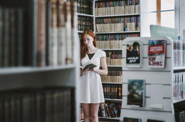 Inna Mosina YOUNG WOMAN READING BOOK IN LIBRARY Women