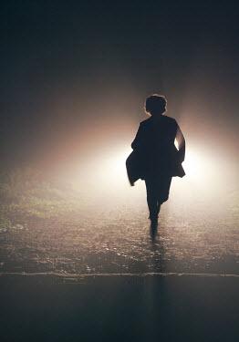 Mark Owen SILHOUETTE OF WOMAN RUNNING AT NIGHT Women