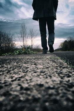 Tim Robinson MAN WALKING AT SIDE OF ROAD Men