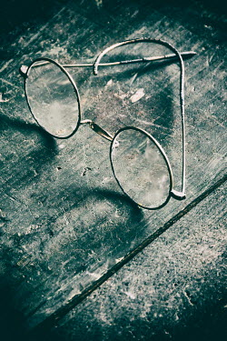 Mohamad Itani VINTAGE SPECTACLES ON WOODEN SURFACE Miscellaneous Objects