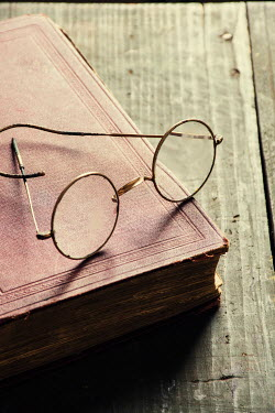 Mohamad Itani VINTAGE SPECTACLES LYING ON BOOK Miscellaneous Objects