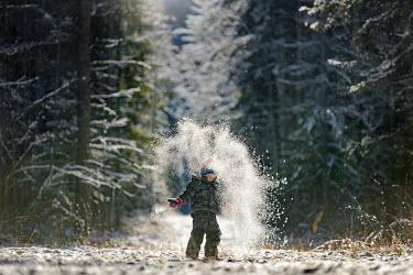 Viktoria Haack LITTLE BOY PLAYING IN SNOW Children