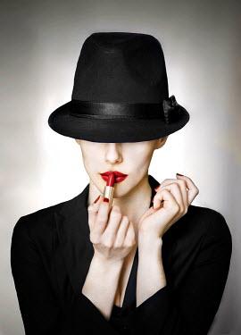 Alisa Andrei WOMAN IN HAT APPLYING RED LIPSTICK Women