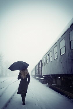 Carmen Spitznagel WOMAN STOOD BY TRAIN IN SNOWY WEATHER Women