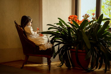 Irma Kanova YOUNG GIRL SITTING BY PLANT INDOORS Children