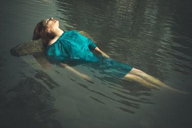 Irma Kanova WOMAN LYING ON ROCK IN LAKE WATER Women