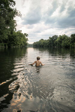 Stephen Carroll YOUNG BOY SWIMMING IN LAKE Children