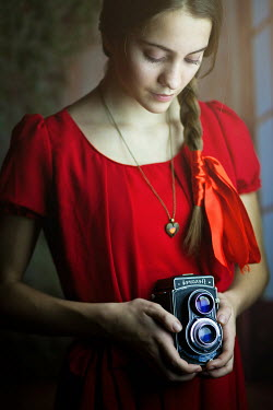 Ildiko Neer YOUNG GIRL HOLDING VINTAGE CAMERA See All People