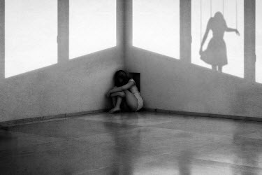 Elena Bovo GIRL IN THE CORNER OF ROOM WITH PUPPET SHADOW Women