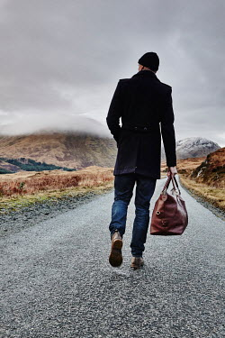 Andy & Michelle Kerry MAN WITH BAG ON EMPTY COUNTRY ROAD Men