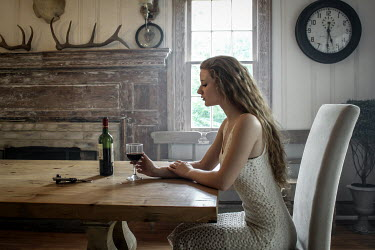 Stephen Carroll WOMAN DRINKING WINE AT TABLE INDOORS Women