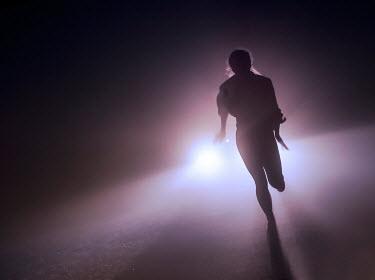 Terry Bidgood WOMAN RUNNING IN FRONT OF CAR AT NIGHT Women