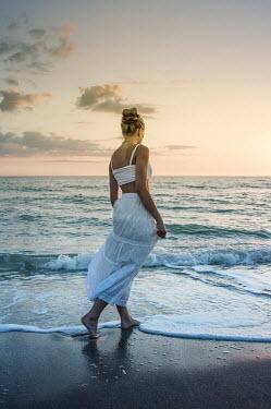 Terry Bidgood WOMAN WITH HAIR UP PADDLING IN OCEAN Women