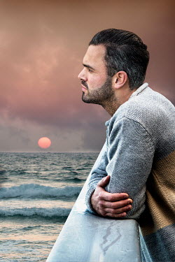 Yolande de Kort MAN LEANING ON RAIL BESIDE OCEAN Men