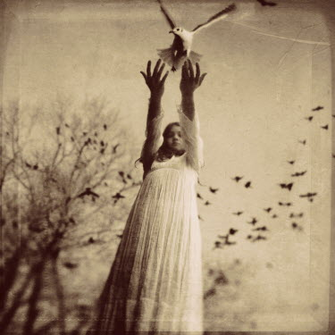 Kamil Vojnar YOUNG GIRL RELEASING DOVE Children