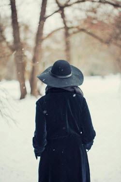 Joanna Jankowska WOMAN STANDING IN SNOWY WOOD Women