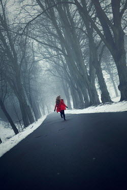 Karina Simonsen WOMAN RUNNING IN WINTRY FOREST Women
