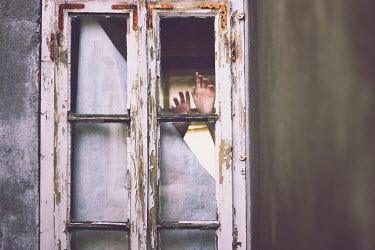 Isabella Bubola HANDS AGAINST DILAPIDATED WINDOW See All People