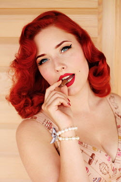 Jasenka Arbanas YOUNG RED HAIRED WOMAN EATING CHOCOLATE Women