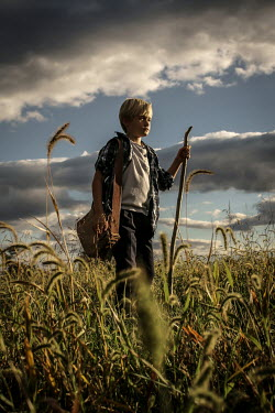 Stephen Carroll BOY STANDING IN COUNTRYSIDE FIELD Children